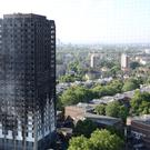 The blackened shell of Grenfell Tower looms over north Kensington (Rick Findler/PA)
