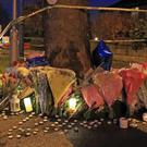Floral tributes near the scene of the crash on Stonegate Road (Peter Byrne/PA)