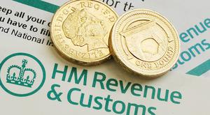 A former HMRC employee who lied about being a single parent to steal tax credits has been given a suspended sentence.