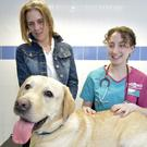 Chino with vet Rebecca Woolfson and owner Elizabeth Brydon (PDSA/PA)