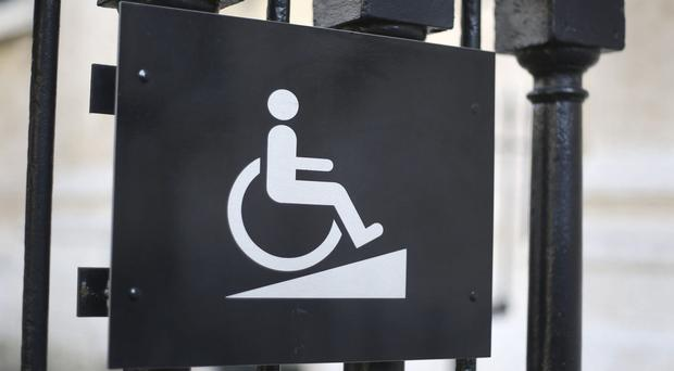 Three out of five of those questioned said they would be worried about the cost of employing a disabled person (Philip Toscano/PA)