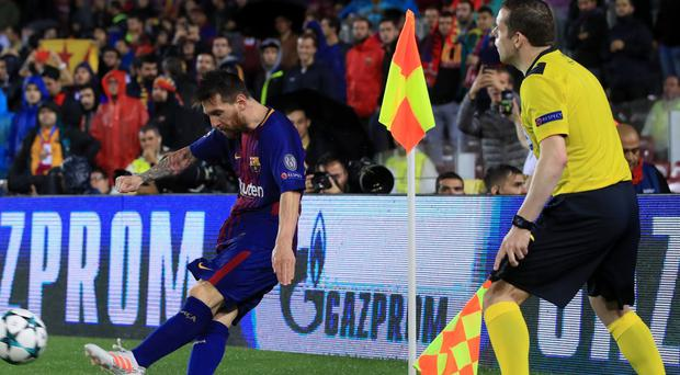 Tory MP and assistant referee Douglas Ross watches Lionel Messi take a corner (John Walton/Empics/PA)