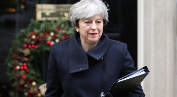 "Theresa May has insisted that she remains ""on course to deliver on Brexit"" despite her humiliating defeat in the House of Commons (Rick Findler/PA)"