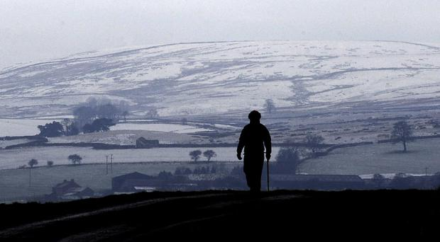 The commission calls for a UK-wide strategy for loneliness across all ages (John Giles/PA)