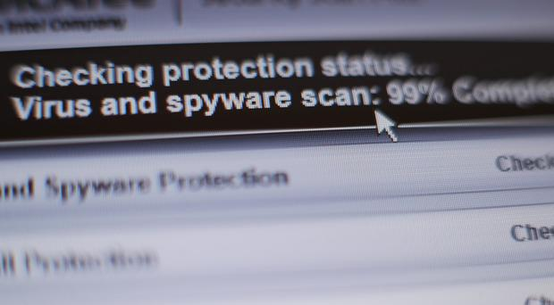 Internet security software performing an anti-virus and anti-spyware scan on a laptop (Yui Mok/PA)