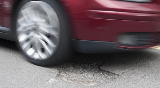 'The Department for Infrastructure paid out more than 75 claims a month on average for damage due to road surface defects' (stock photo)