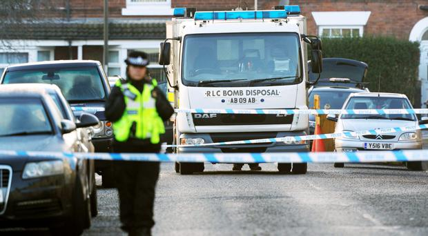 Police and the Bomb Disposal Unit outside a property in Chesterfield, Derbyshire (Aaron Chown/PA)