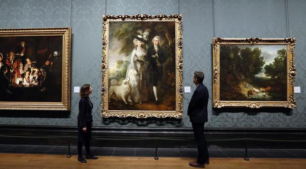 The Morning Walk, on display at the National Gallery in London after it was repaired (PA)