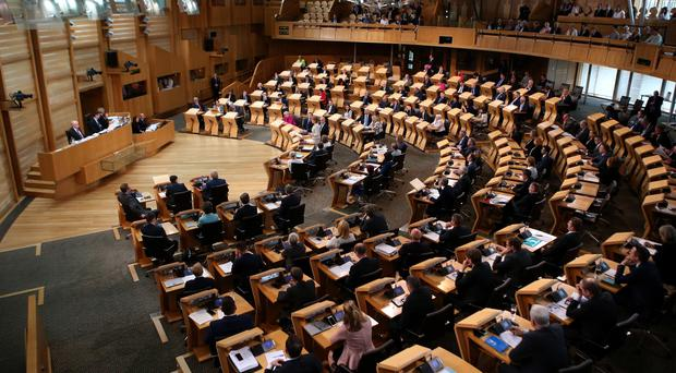 MSPs unanimously backed the new law passed in the Scottish Parliament (Andrew Milligan/PA)