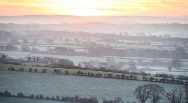 Mist hangs over frosty fields as the sun rises over the Somerset Levels (Ben Birchall/PA)