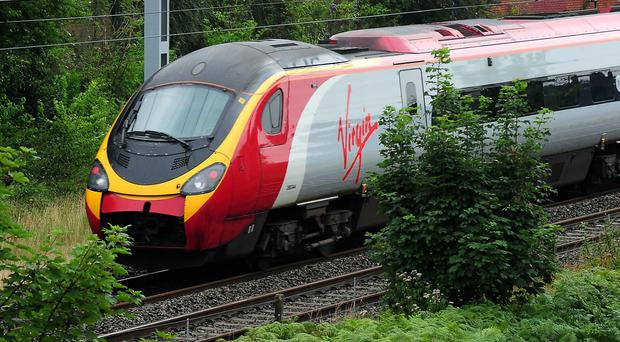 Embargoed to 0001 Friday December 15 File photo dated 15/08/12 of a Virgin train, as members of the Rail, Maritime and Transport union (RMT) and Transport Salaried Staffs Association (TSSA) on Virgin Trains West Coast are taking action, with further 24-hour stoppages planned on December 22 and January 5, 8, 26 and 29.