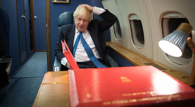 Foreign Secretary Boris Johnson during a flight to Moscow (Stefan Rousseau/PA)