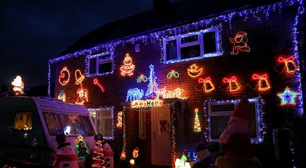 Christmas lights on a house in Westfield, East Sussex (Gareth Fuller/PA)