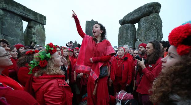 People gather at Stonehenge in Wiltshire (Andrew Matthews/PA)