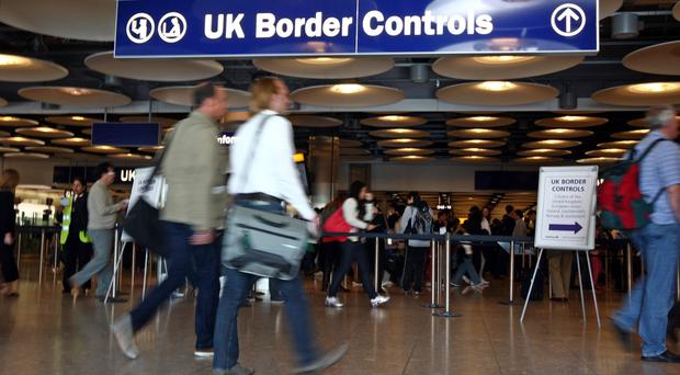 A report has called for the UK to introduce a visa waiver system (Steve Parsons/PA)
