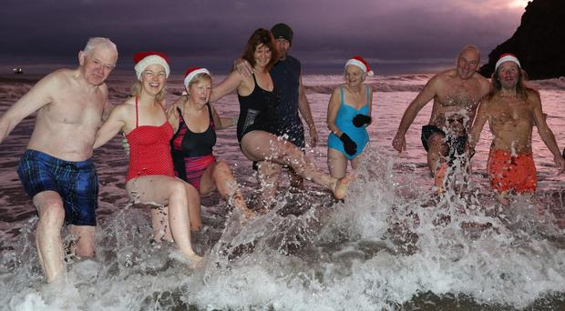 The King Edward's Bay swimmers enjoy a Christmas Day dip at sunrise (Owen Humphreys/PA)