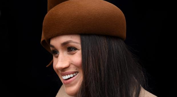 Meghan Markle wore a stylish brown hat on Christmas Day (Joe Giddens/PA)