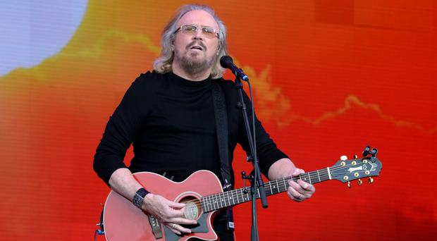 Barry Gibb is recognised for his services to music and charity (Ben Birchall/PA)