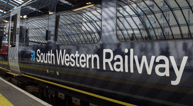 The SWR strike will disrupt services to and from London Waterloo, the busiest railway station in the country (Victoria Jones/PA)