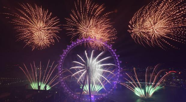 Fireworks light up the sky over the London Eye in central London (Victoria Jones/PA)