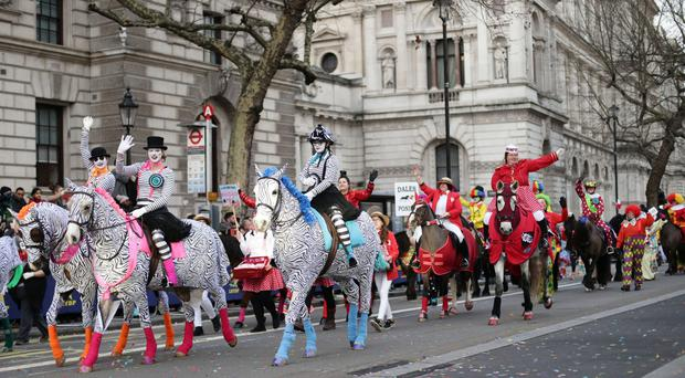 People take part in the London New Year's Day Parade.