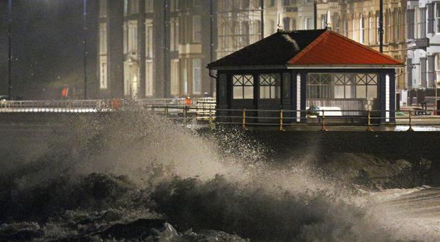 Waves crash against the sea wall in Aberystwyth in west Wales as Storm Eleanor hits the UK (Aaron Chown/PA)
