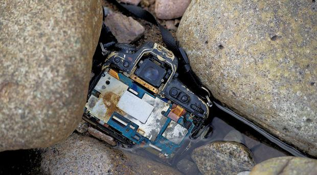Charlie Davidson's Nikon DLSR camera found wedged in rocks (Peter Sandground/PA)