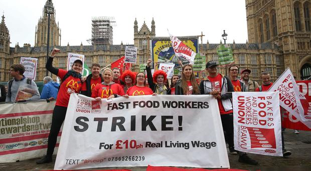 Supporters and workers from McDonald's restaurants in Cambridge and Crayford, SE London, during a rally at Old Palace Yard, London (Philip Toscano/PA)