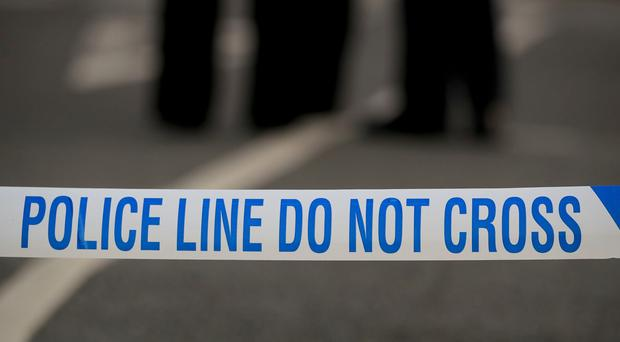 Police officers arrested a man on suspicion of murder after a woman died in the Ilford area (Peter Byrne/PA)