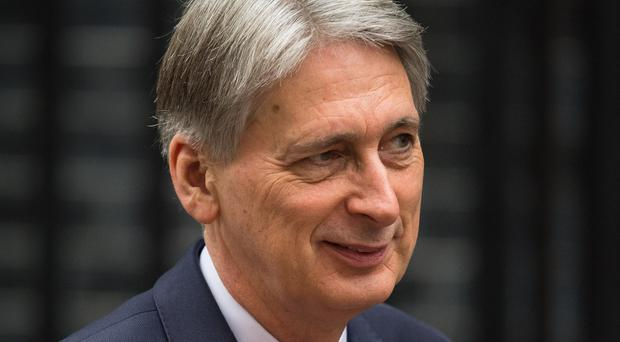 Chancellor Philip Hammond has left the door open to the UK signing up to a customs agreement with the EU (Dominic Lipinski/ PA)