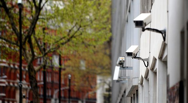 CCTV cameras on the side of a building in central London (Clive Gee/PA)