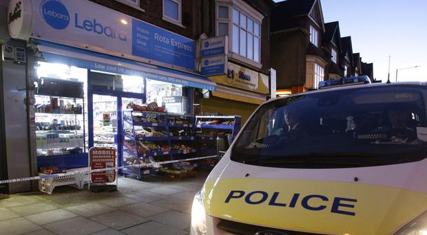Police outside the shop in Mill Hill, north London ( Yui Mok/PA)