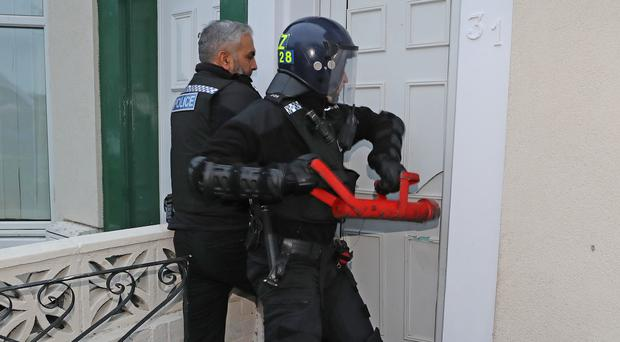 Police raid an address in Stockton, Teesside, as part of a crackdown on people trafficking and serious sexual offences (Owen Humphrys/PA)