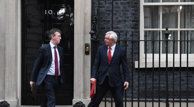 Attorney General Jeremy Wright, left, and Brexit Secretary David Davis leaving 10 Downing Street (Stefan Rousseau/PA)