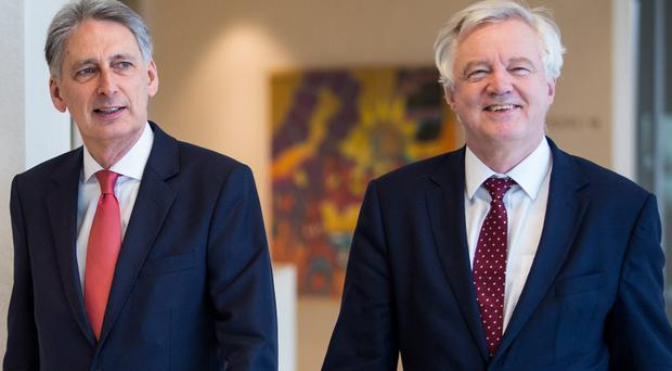 Chancellor Philip Hammond and Brexit Secretary David Davis are launching a charm offensive in Germany (Jack Taylor/PA)