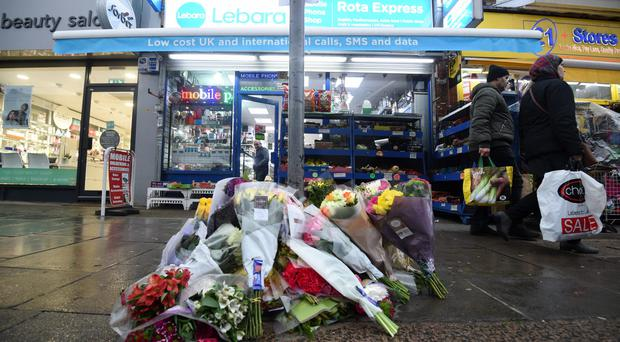 Tributes outside the shop in Mill Hill (Kirsty O'Connor/PA)