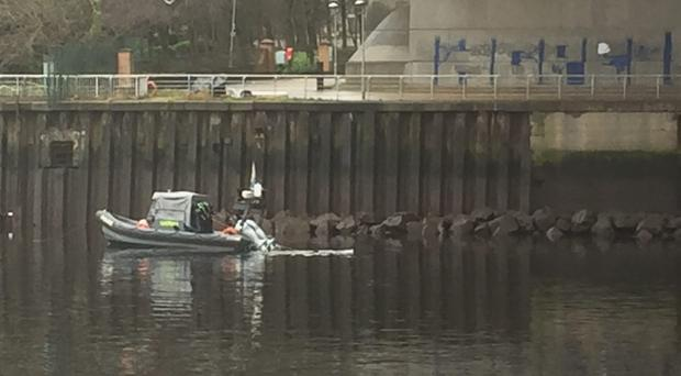 Divers search underneath Kingston Bridge (Lucinda Cameron/PA)