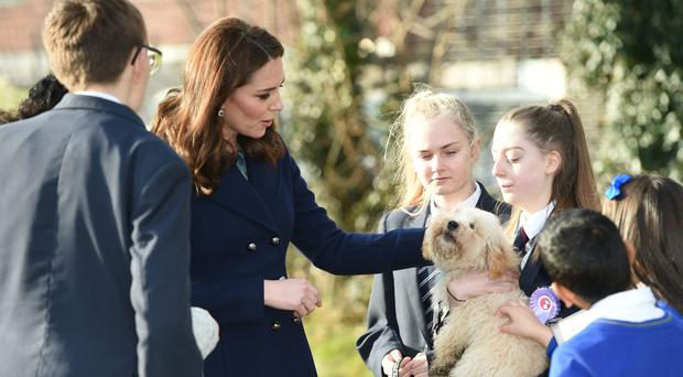 The Duchess of Cambridge visiting the Reach Academy Feltham, in London, a school working in partnership with Place2Be and other organisations to support children, families and the school community (Eddie Mulholland/Daily Telegraph/PA)