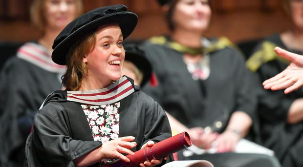 Paralympian Ellie Simmonds receives an honorary degree from Swansea University during the degree ceremony for the College of Human and Health Sciences in the Great Hall at the university (Ben Birchall/PA)