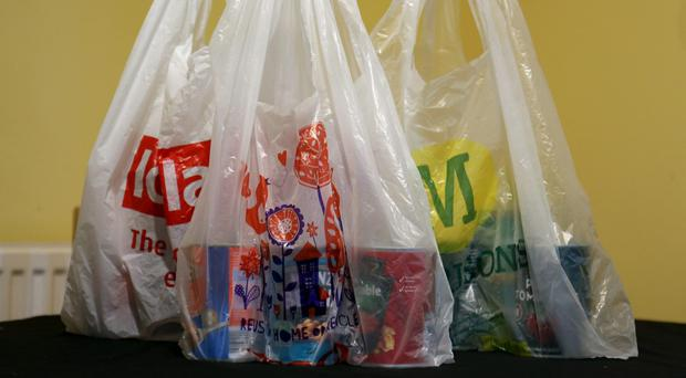 The 5p charge for plastic carrier bags will be extended to all retailers in England (Chris Radburn/PA)
