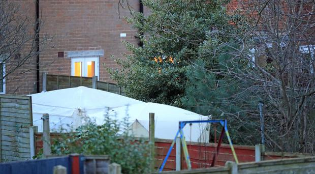 Police tents in the garden in Reddish (Danny Lawson/PA)