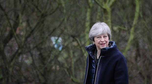 Prime Minister Theresa May walks through the grounds of the Wildfowl and Wetland Trust ahead of a speech where she set out her vision for protecting the environment (Dan Kitwood/PA)