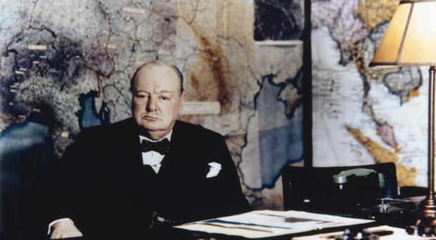 Winston Chrchill seated at his desk in the No 10 Annexe Map Room in May 1945 (Imperial War Museums/PA)