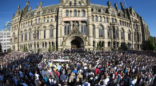 Civic leaders, politicians, police and the public gather for a vigil in Albert Square outside Manchester Town Hall following the bombing (Danny Lawson/PA)