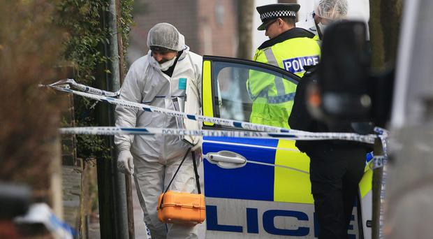 A forensic officer at the scene in Matlock Road, Reddish (PA)