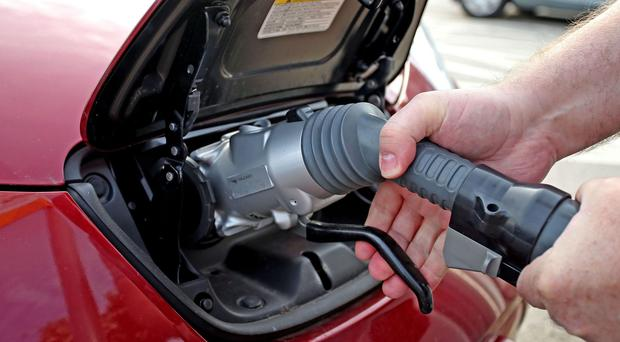 Just five councils have taken up a Government offer to help with cost of electric car charging (PA)