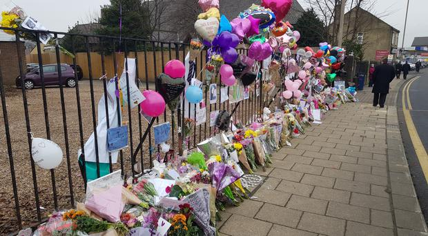 Tributes left on Wakefield Road, Huddersfield, following the death of teenager Katelyn Dawson (Dave Higgens/PA)