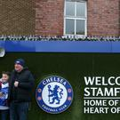 Fans outside Chelsea's Stamford Bridge ground (Jonathan Brady/PA)