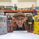 Auctioneer Richard Edmonds with some of the robots (Ellipsis Communication/PA)