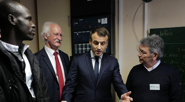French President Emmanuel Macron visits a migrant centre (AP Photo/Michel Spingler, Pool)